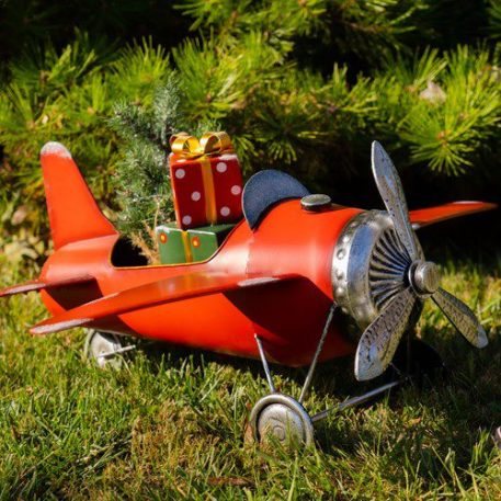Small Red Airplane with Lighted Christmas Tree and Gifts